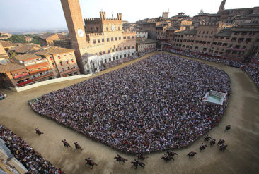 Horses and jockeys compete in a general practice of the Palio horse race on the eve of the competition on July 1, 2009 on Piazza del Campo in Siena, Tuscany. The Palio races which take place twice a year on July 2 and August 16, are  traditional horse races which started in 1656 and are dedicated to Virgin Mary and to Madonna of Provenzano. Horses and jockeys of the 17 areas (contrade) of the city, dressed in the appropriate colors of their wards, compete ten by ten, after a magnificient pageant, the Corteo Storico.  AFP PHOTO / Fabio Muzzi (Photo credit should read FABIO MUZZI/AFP/Getty Images)